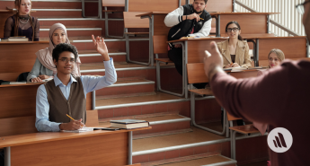 College students in class hands raised